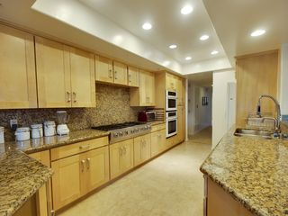 Encinitas condo photo - gourmet kitchen with travertine and granite