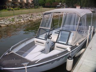 18.5' boat rental option with new seats, new full camper canvas. - Alexandria Bay cottage vacation rental photo