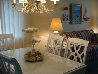 Surfside Beach condo photo - Seating for 6 at the glass topped dining table