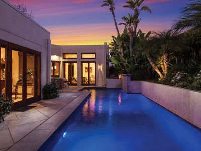 Saltwater Pool frames this home