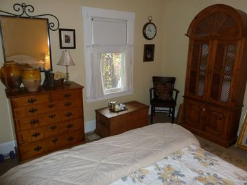 This is guest bedroom 2 with lots of antique furiture.