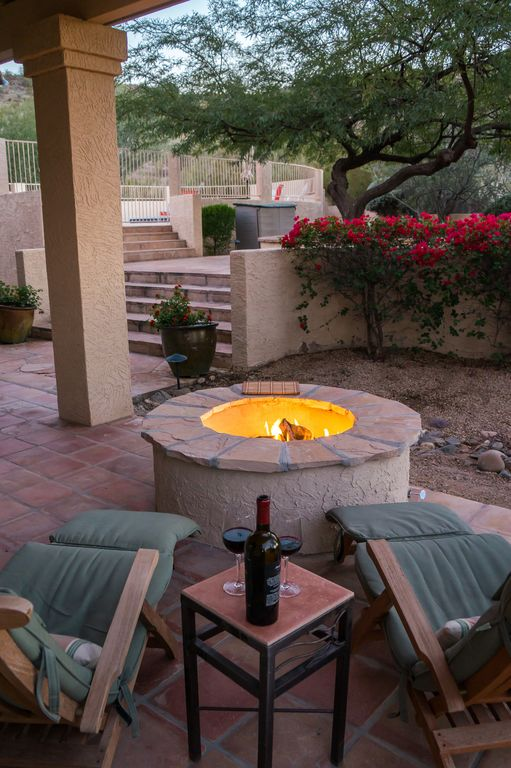 cozy up to the gas firepit under patio cover