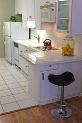 Waikiki studio photo - Full Kitchen, clean, crisp and ready for your creations Mai Tai Martini anyone?