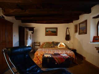 Antognolla farmhouse photo - Second floor Double Bedroom, with private terrace, entrance & and fireplace.