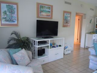 Grand Cayman condo photo - Living room with 40in tv with dvd, ipod dock, stereo