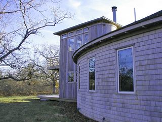 Chilmark house photo - Wintertime! Showing the house's arc and 2nd story LR with its railed deck.