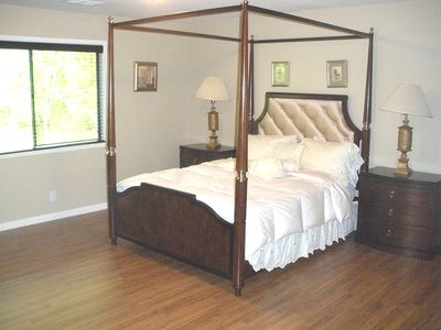 Large Guest Bedroom with Classic Canopy bed and 2 nightstands and desk