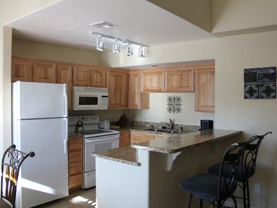 Well appointed kitchen with granite counter tops and all cooking equipment