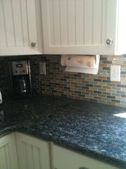Wellfleet house photo - new kitchen glass tile backsplash