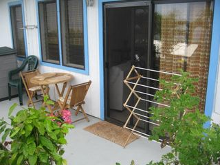 Keauhou studio photo - Cute private patio with tropical plants and ocean view!