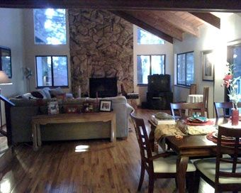 Great Room and Dining Room combination looking out on wooded deck