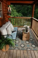Pigeon Forge cabin photo - The beautifully decorated seating area on the front porch.