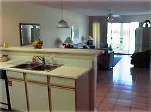 Fully stocked kitchen, dinning rm seats 6, living rm with hide-away queen bed