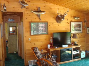 Upstairs living room with fish mounts from Wilson Lake!