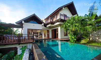 Exterior of Villa Karma Cantik, swimming pool,deck with sun bed