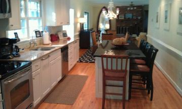Kitchen with 9 foot island! Seating for 6 at island,6 at dining table, 3 in kit