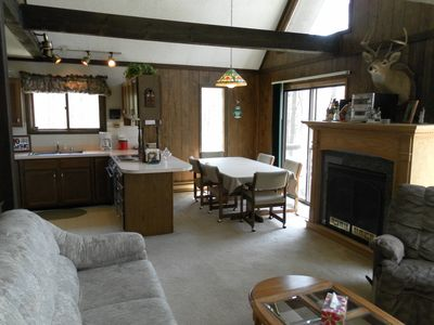 The spacious Living area with cozy fireplace gives a warm inviting atmosphere.