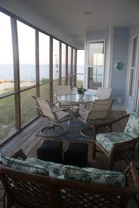 The screened porch overlooking the beach is where you will spend your time.