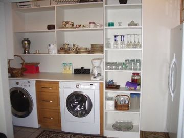 Kitchen area with new washer,dryer and side-by-side frig with ice maker