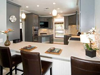 Crystal Shores house photo - Breakfast bar and view of kitchen.