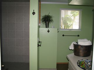Anna Maria house photo - Spacious Master Bathroom with large walk-in shower that has a bench
