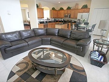 "Family room features 52"" HD LCD Cable TV, leather sectional sofa and tile floor"