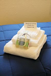 Locally-made bath  amenities and white fluffy towels for eachroom.