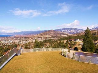 Penticton house photo - fenced grass play area