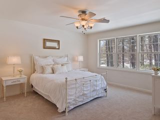Woodstock house photo - Master bedroom features picture window, 2 walk-in closets, + flat-screen TV
