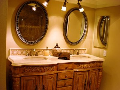 Luxurious master bathroom with walk in closet and double sinks.
