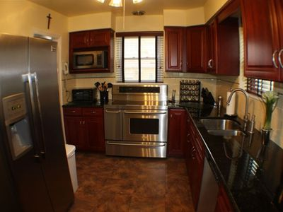 Kitchen tile floor and granite counter, breakfast bar