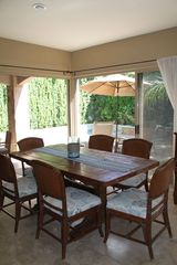 Cabo San Lucas house photo - Dining area seats 6 with large patio doors that bring the outdoors in.