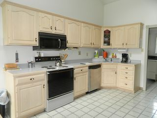 Stratton house photo - Fully stocked kitchen, beautiful tile flooring