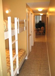 Twin size built-in bunk beds...hallway to living/dining room area.