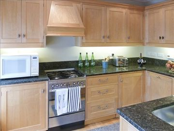 Newly remodeled kitchen with every appliance; cherrywood & gray granite counters