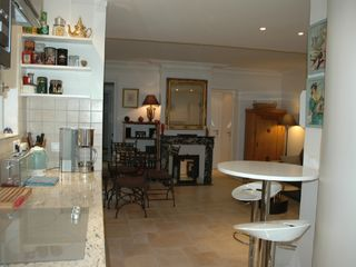 7th Arrondissement Eiffel Tower apartment photo - Kitchen opening to Dining area