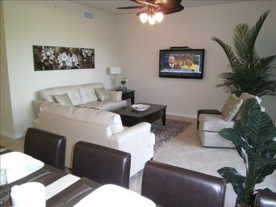 "Relax in the luxurious living room with 50"" plasma TV overlooking the 13th green"