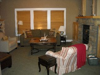 Bend house photo - The main living room is cozy with a gas fire place.