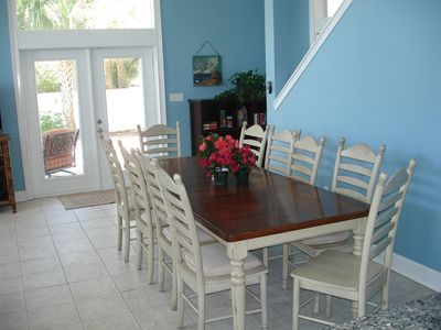 Dining table seats 10 with 4 additional bar stools