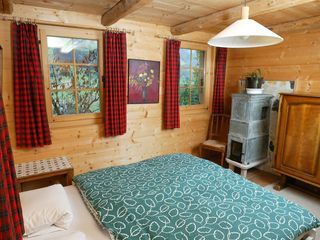 Val-d'Illiez chalet photo - Master bedroom with adjoining bath, authentic decorations