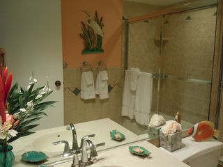 Grand Cayman condo photo - Ensuite guest bath has tub/shower combo