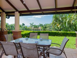 Tamarindo condo photo - Biggest covered terrace area with garden and a view