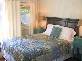 Cortez cottage photo - Tropical master bedroom with queen size bed.