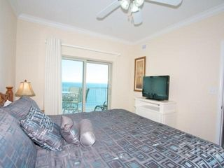 "Gulf Shores condo photo - Master bedroom with king sized bed and 31"" flat screen TV"