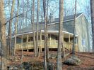 Rear of home which overlooks wooded lot - Masthope cottage vacation rental photo