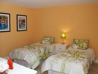 Redington Shores condo photo - Guest bedroom with twin beds, walk in closet, and private entry to guest bath.