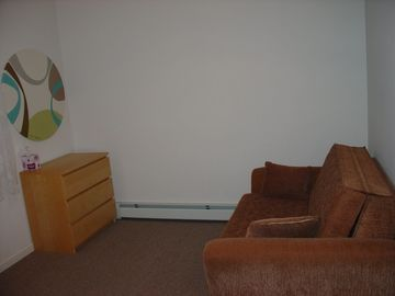 One of the 3 bedrooms upstairs - pull out sofa, closet, ceiling fan, foosball