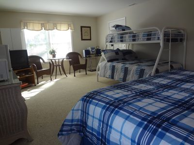 Ground floor bedroom with King size bed, full size bottom bunk and twin top bunk