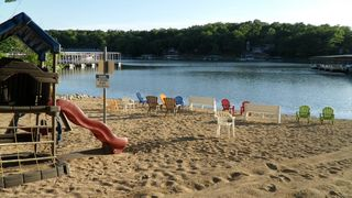Osage Beach condo photo - The Ledges sandy beach playground and lake swimming area