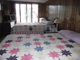 Hayward cabin photo - Upstairs bedroom w/ 2 queen beds, tv and vcr